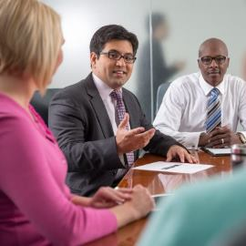 Team Members in Conference Room Meeting