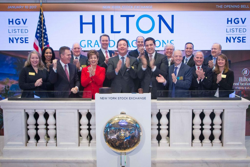 HGV executives celebrate the opening bell at the New York Stock Exchange