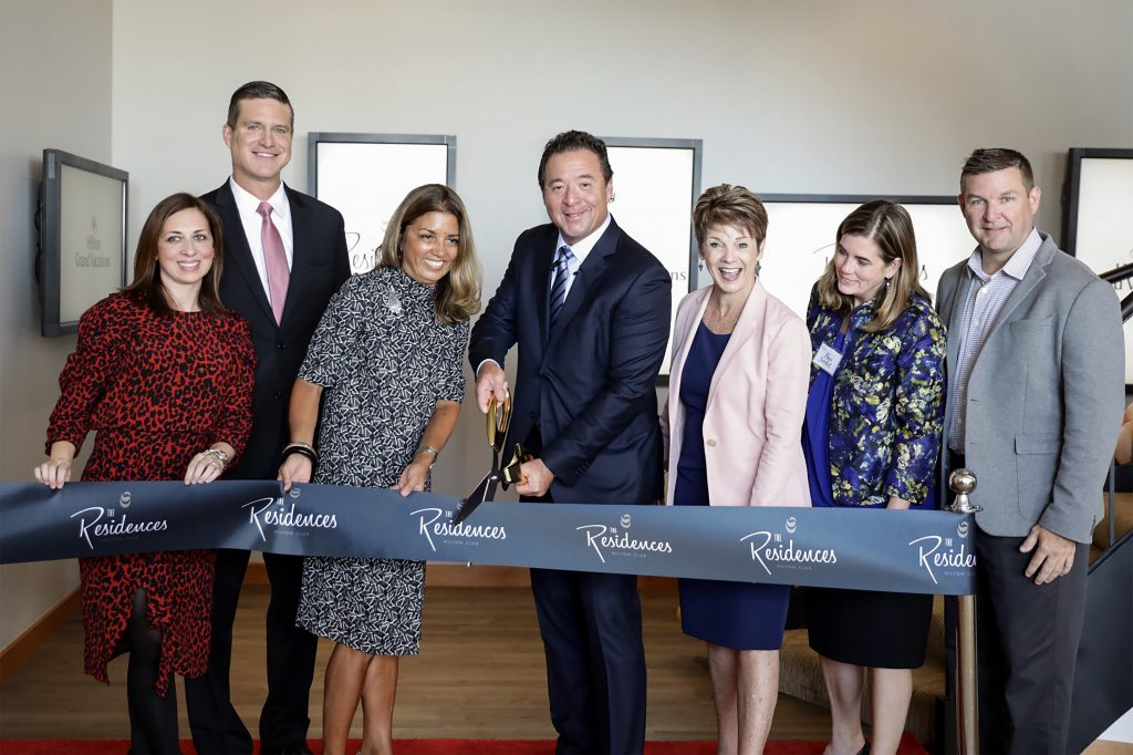 CEO Mark Wang cuts the ribbon at the grand opening ceremony for The Residences by Hilton Club