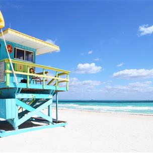 Turquoise lifeguard shack at the beach