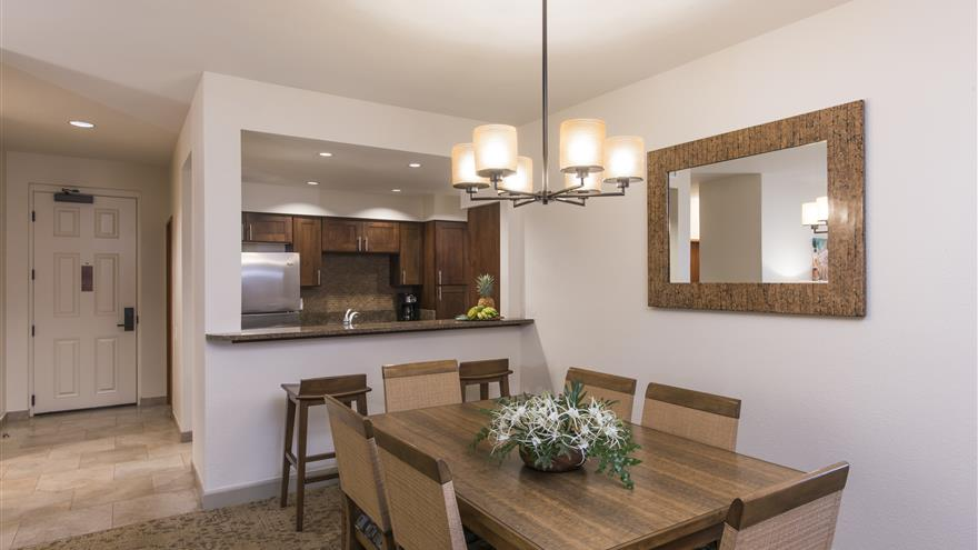 Dining room and kitchen at The Bay Club at Waikoloa Beach Resort located on the Big Island, Hawaii.