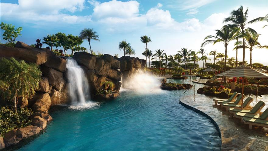 Pool with waterfall at Kings' Land by Hilton Grand Vacations located on the Big Island of Hawaii.