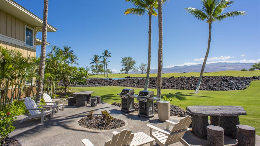 Courtyard with fireplace overlooking Hawaii at Kings' Land by Hilton Grand Vacations located on the Big Island of Hawaii.