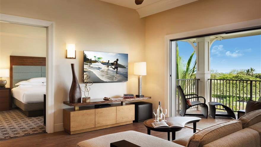 Bedroom, living area and balcony at Kings' Land by Hilton Grand Vacations located on the Big Island of Hawaii.