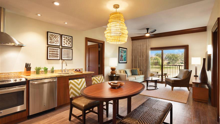 Kitchen and dining area at Kings' Land by Hilton Grand Vacations located on the Big Island of Hawaii.