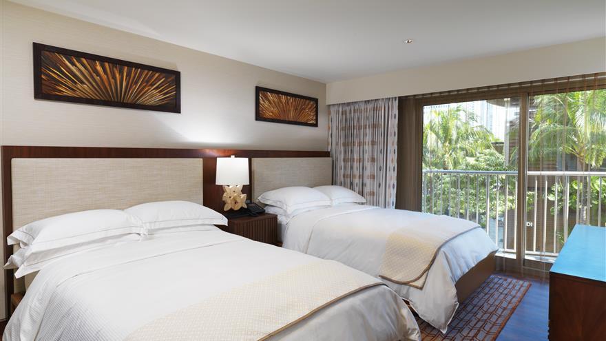 Two bed bedroom at Hokulani Waikiki by Hilton Grand Vacations located at Waikiki Beach, Oahu.