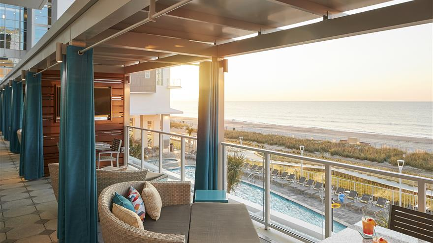 Private balconies over the pool and beach at Ocean Enclave by Hilton Grand Vacations located at Myrtle Beach, South Carolina.