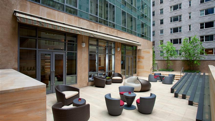 Balcony patio with seating at  West 57th Street by Hilton Club