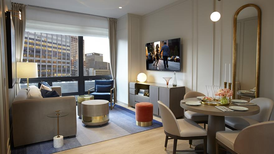 Living room and dining area at The Residences by Hilton Club located in New York City.