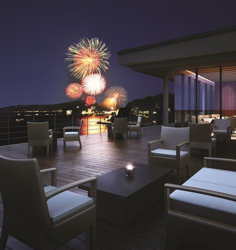 Fireworks light up the sky above Hotel Harvest Atami Izusan.
