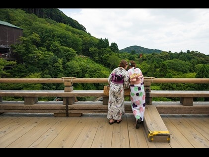 Women enjoying mountain view in Kyoto, Japan.