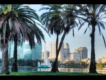 Palm trees and Fountain at Lake Eola Park, Orlando, Florida.