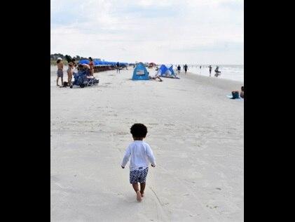 Toddler walking on Hilton Head Beach, South Carolina