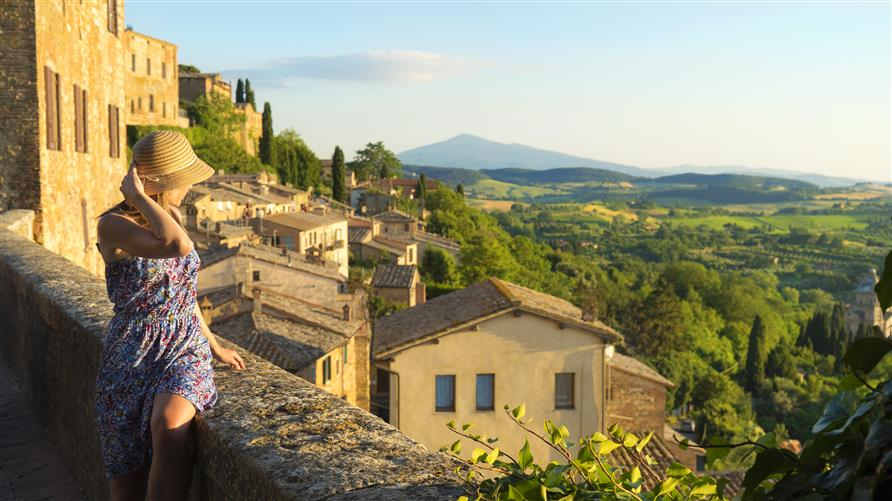 Woman overlook view, Tuscany, Italy