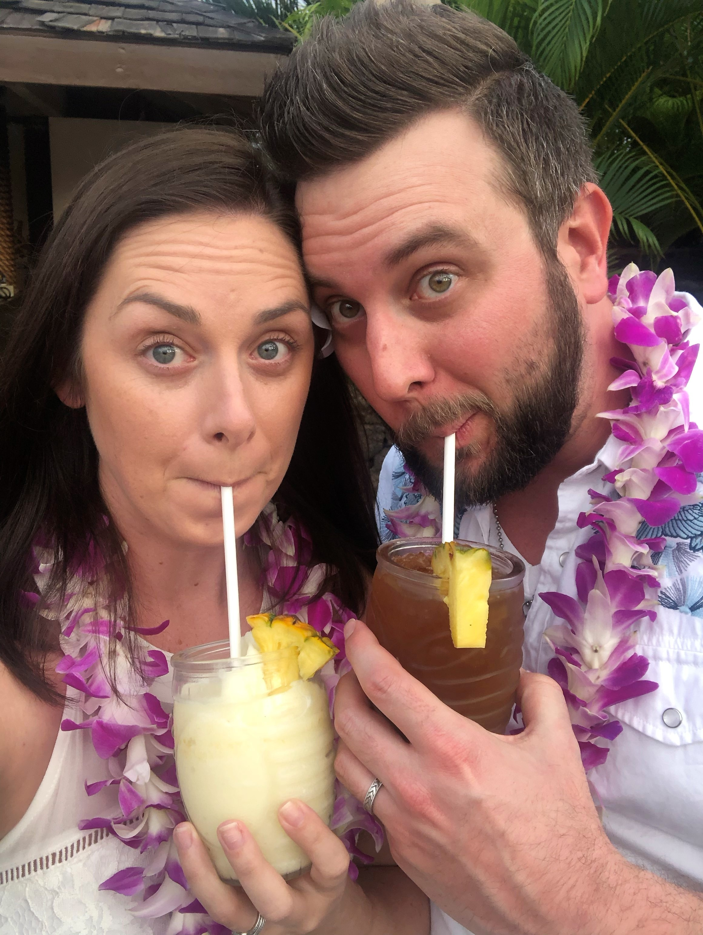 Newlyweds enjoying a drink on their honeymoon at Hilton Grand Vacations Ocean Tower at Hilton Waikoloa Village in Hawaii.