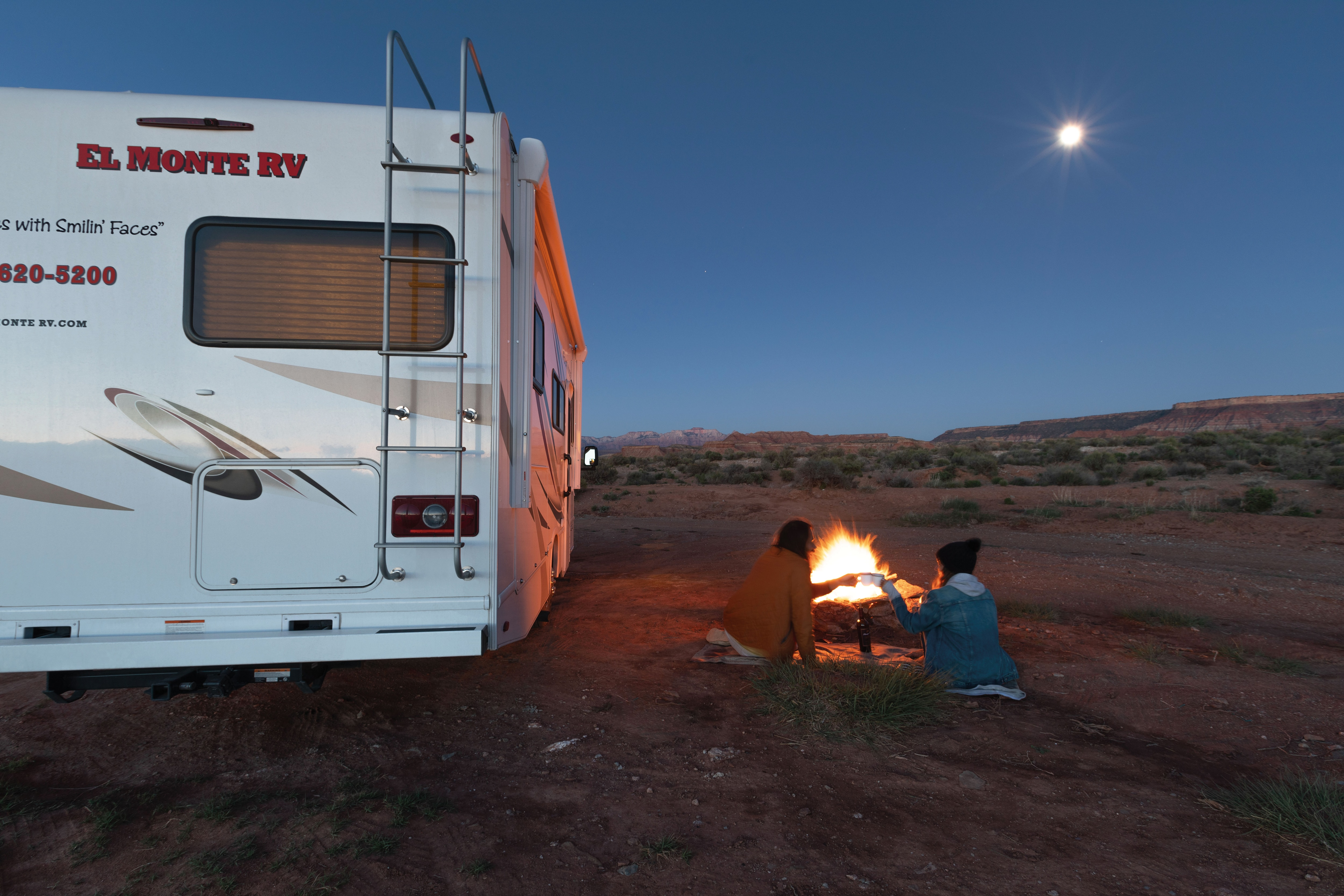 Couple making a camp fire in the desert next to El Monte RV.