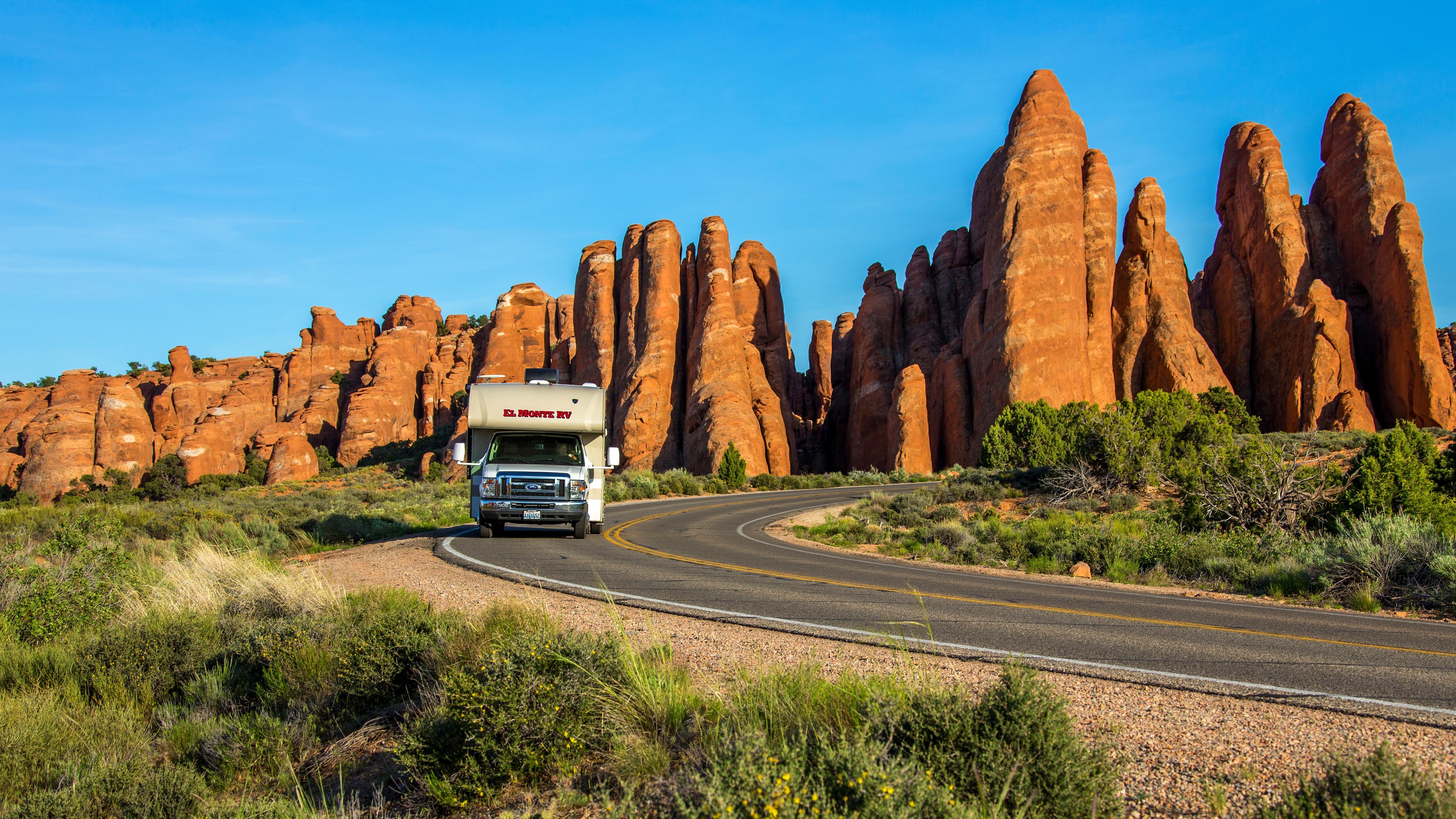 El Monte RV driving through Red Rocks, Utah.