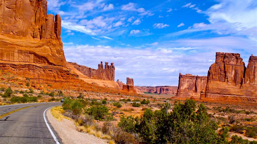 A picture of the open road in Arches National Park, Utah on a Utah National Parks road trip.