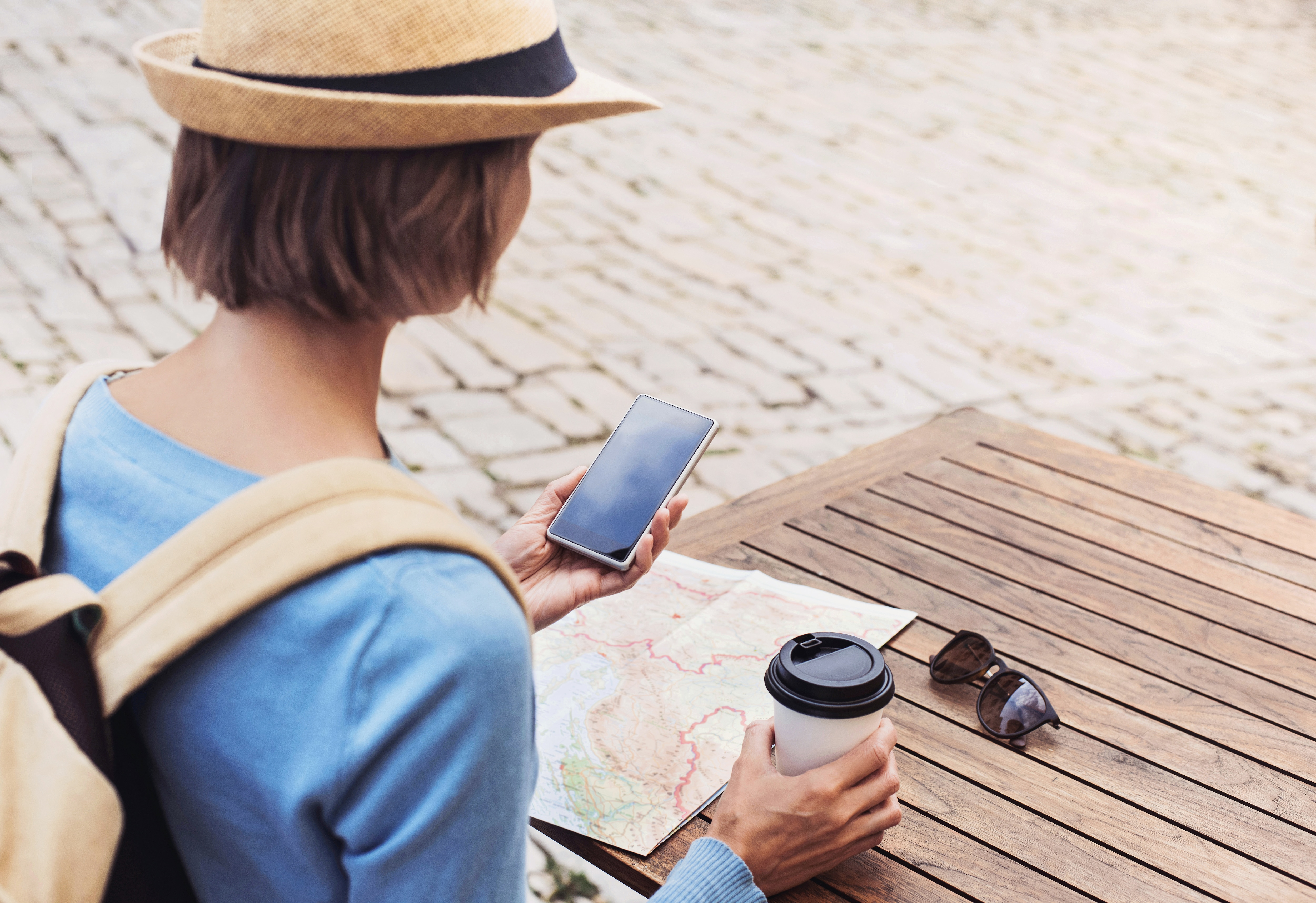 A woman using her phone apps to get around on vacation.