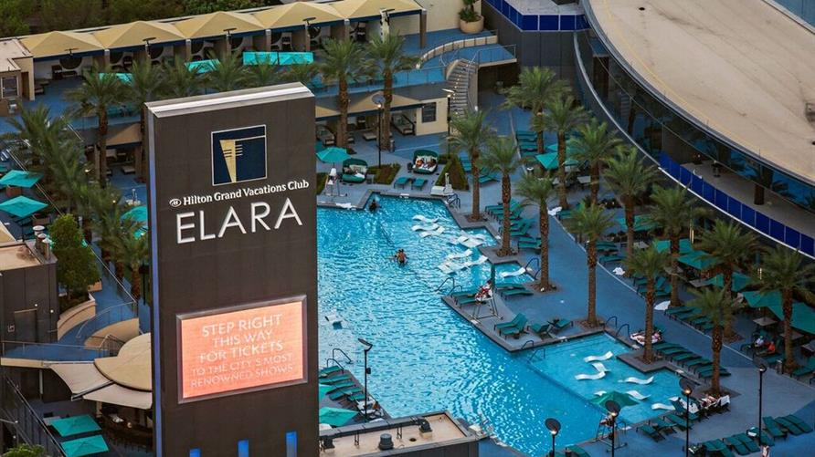 Elara by Hilton Grand Vacations sign and pool in Las Vegas.
