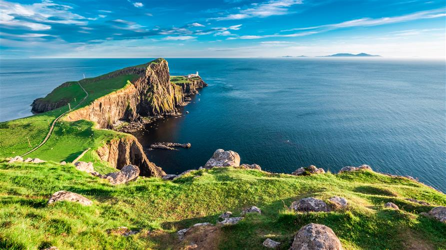 A cliff overlooking the ocean in the Scottish Highlands.