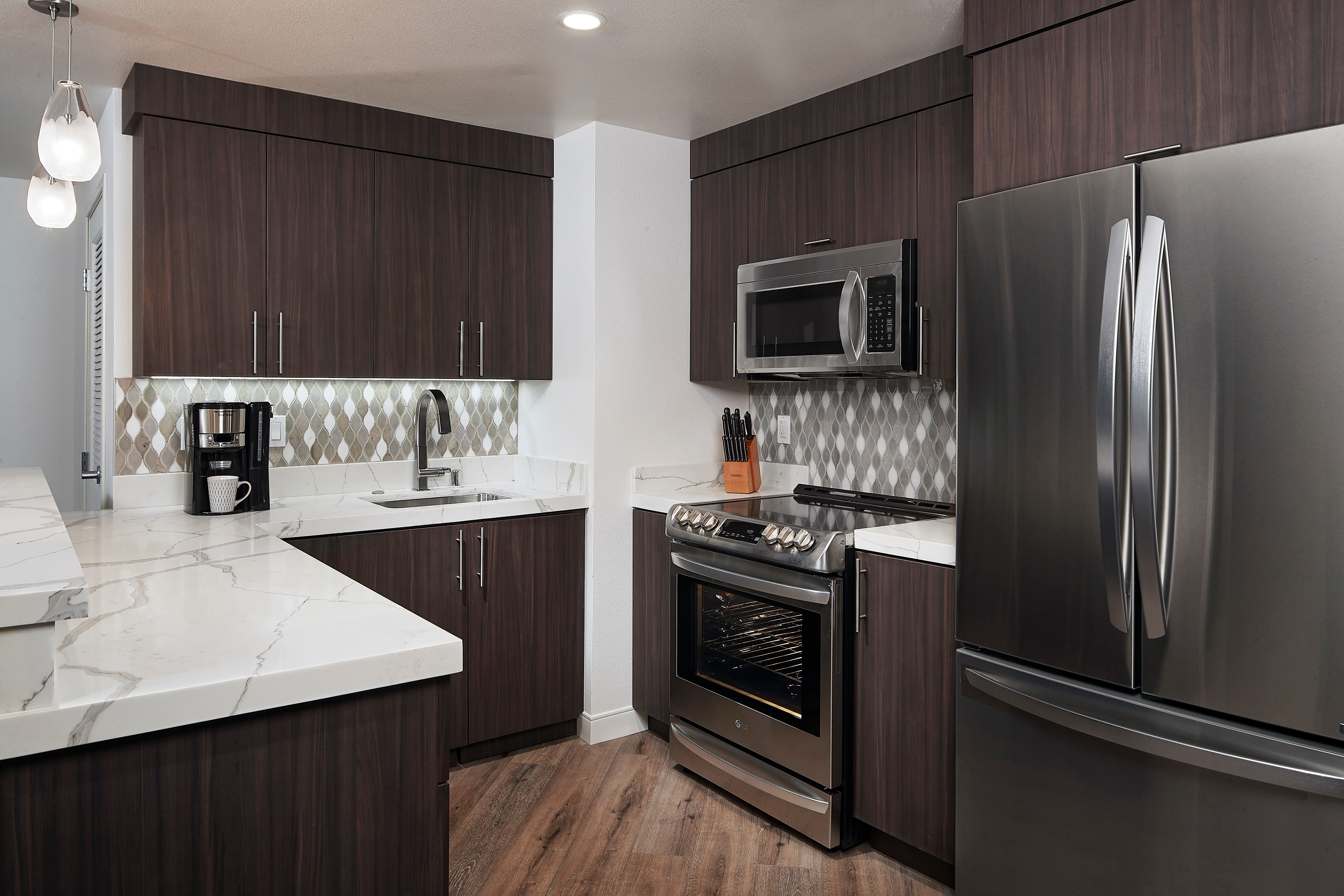 A Fully equipped kitchen in a Hilton Grand Vacations Suite.