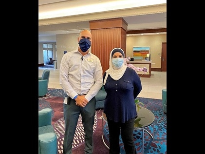Hilton Grand Vacations Loss Prevention Director Ivan Melians and HGV Owner Mrs. Barakat.