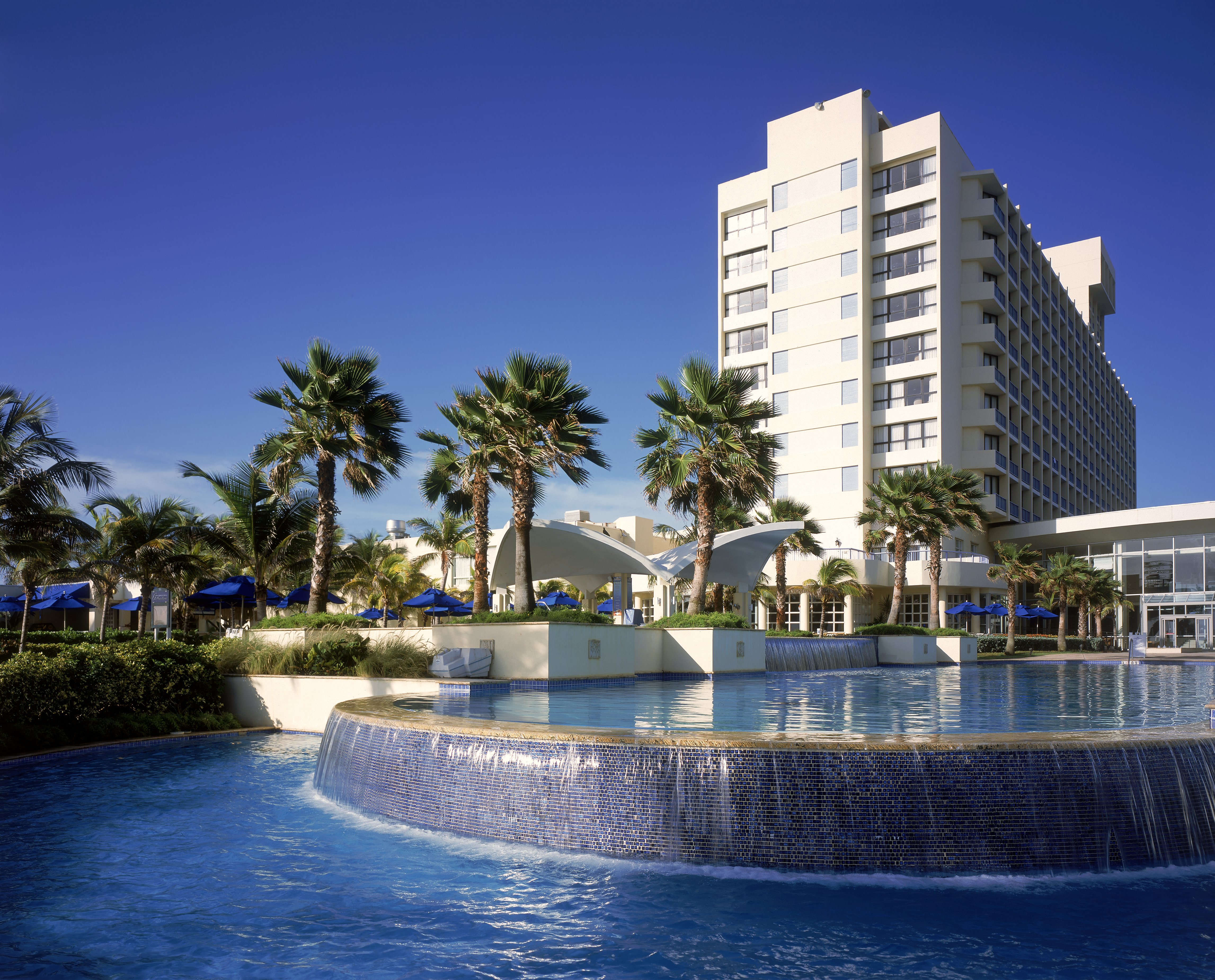 Palm trees and fountain outside the Caribe Hilton in San Juan, Puerto Rico.