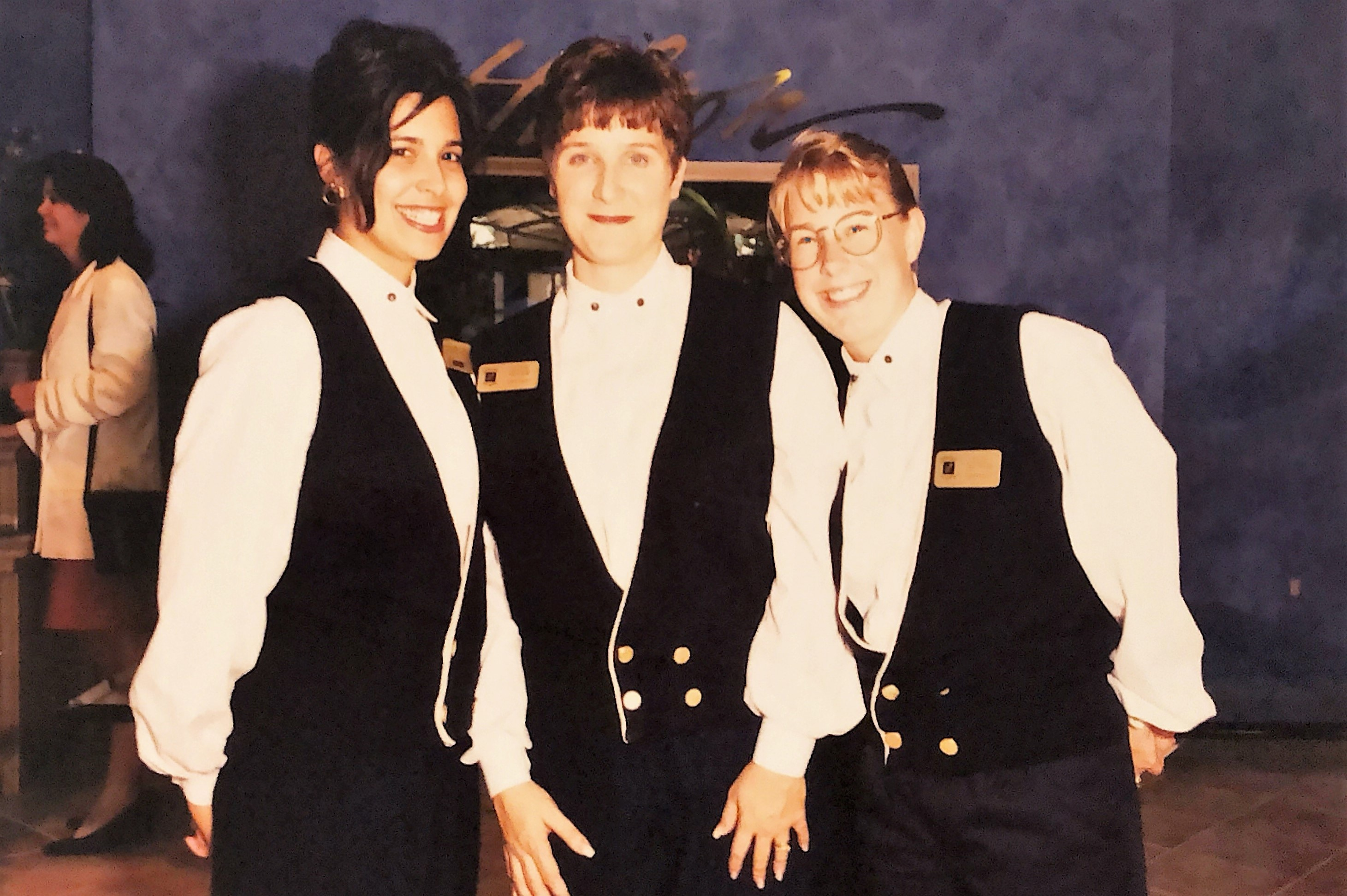 Three Team Members posing and smiling at HIlton Grand Vacations at SeaWorld on opening day in Orlando, Florida.