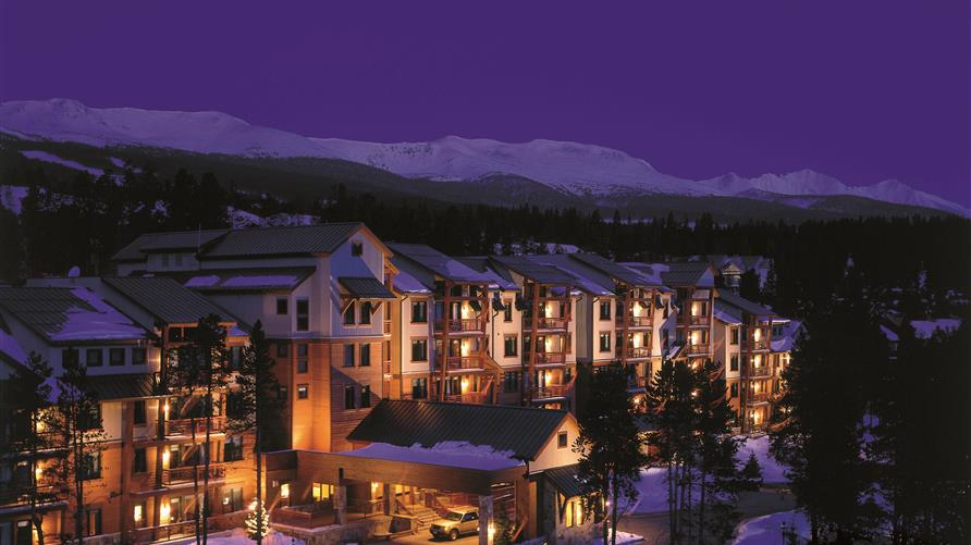 Nighttime aerial view of Hilton Grand Vacations Valdoro Mountain Lodge in Breckenridge, Colorado.