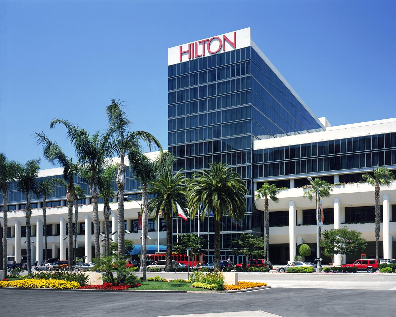Exterior shot of a Hilton hotel entrance.