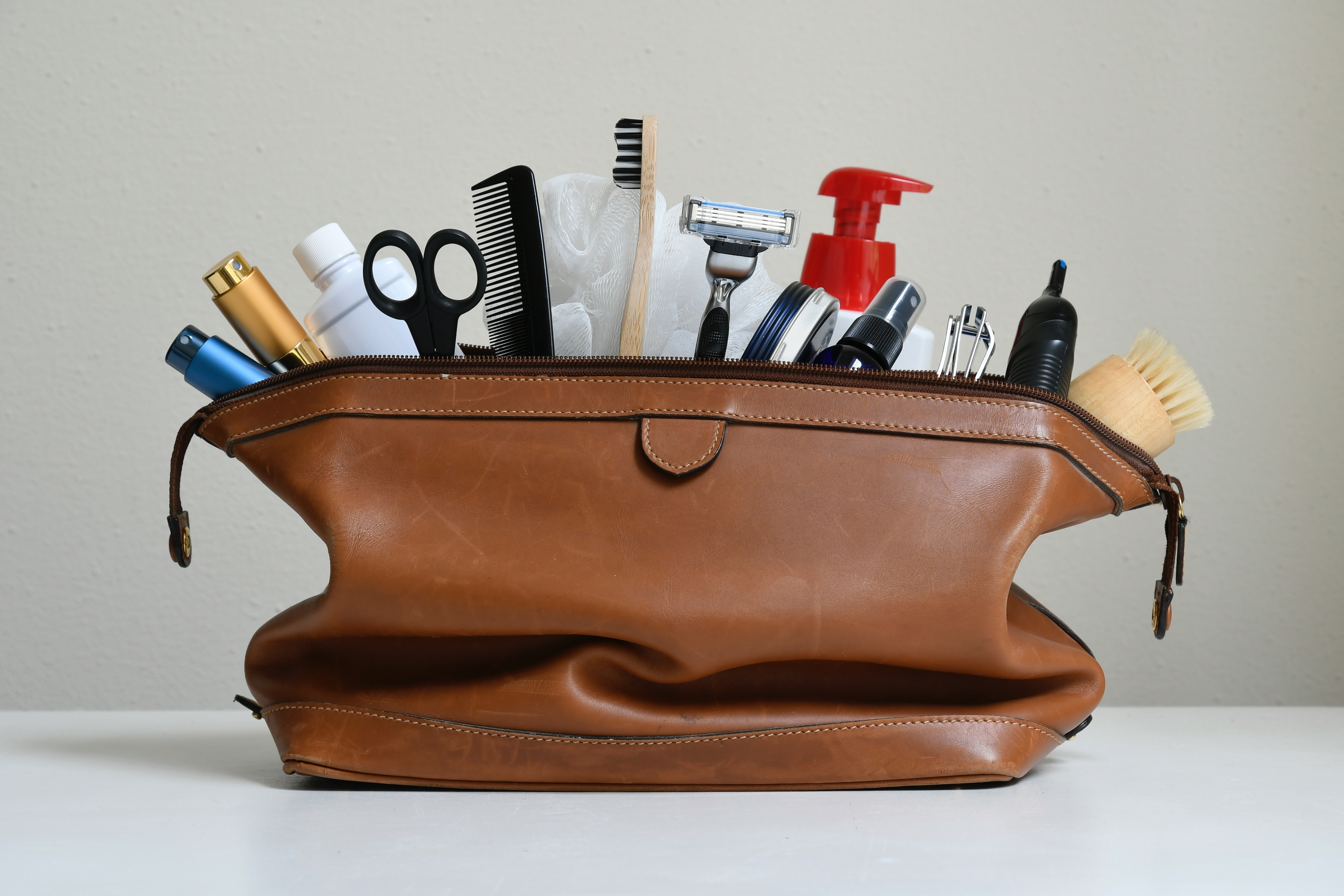 Travel toiletries in a brown travel bag.