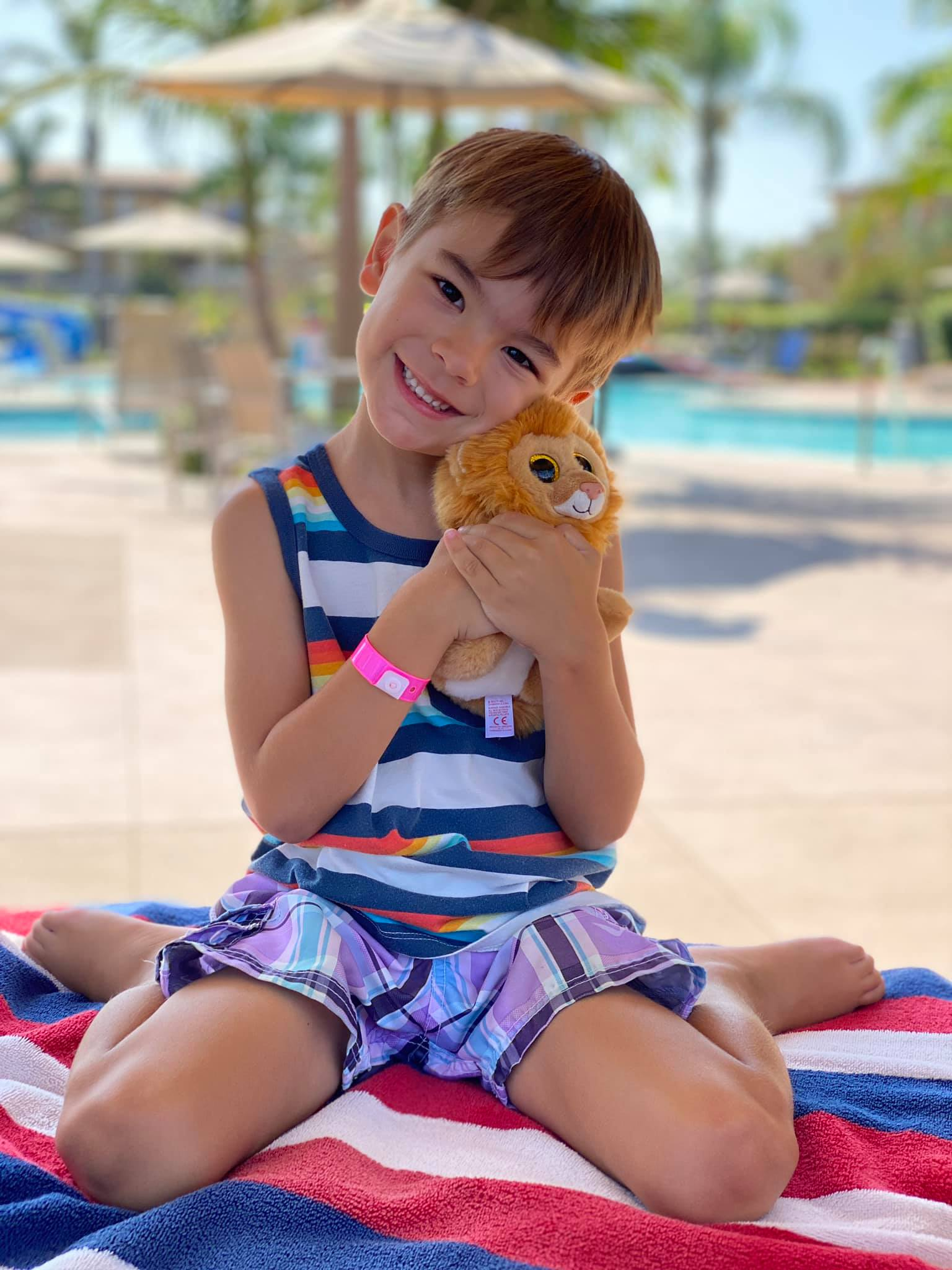 Hilton Grand Vacations at Marbirsa Guest, Jax, posing with Little Louie the Lion.