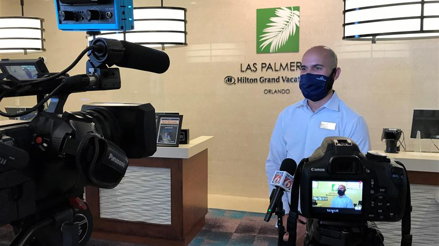 Hilton Grand Vacations Orlando Team Member being interview by News 6 in Orlando after being honored for saving Owners life.
