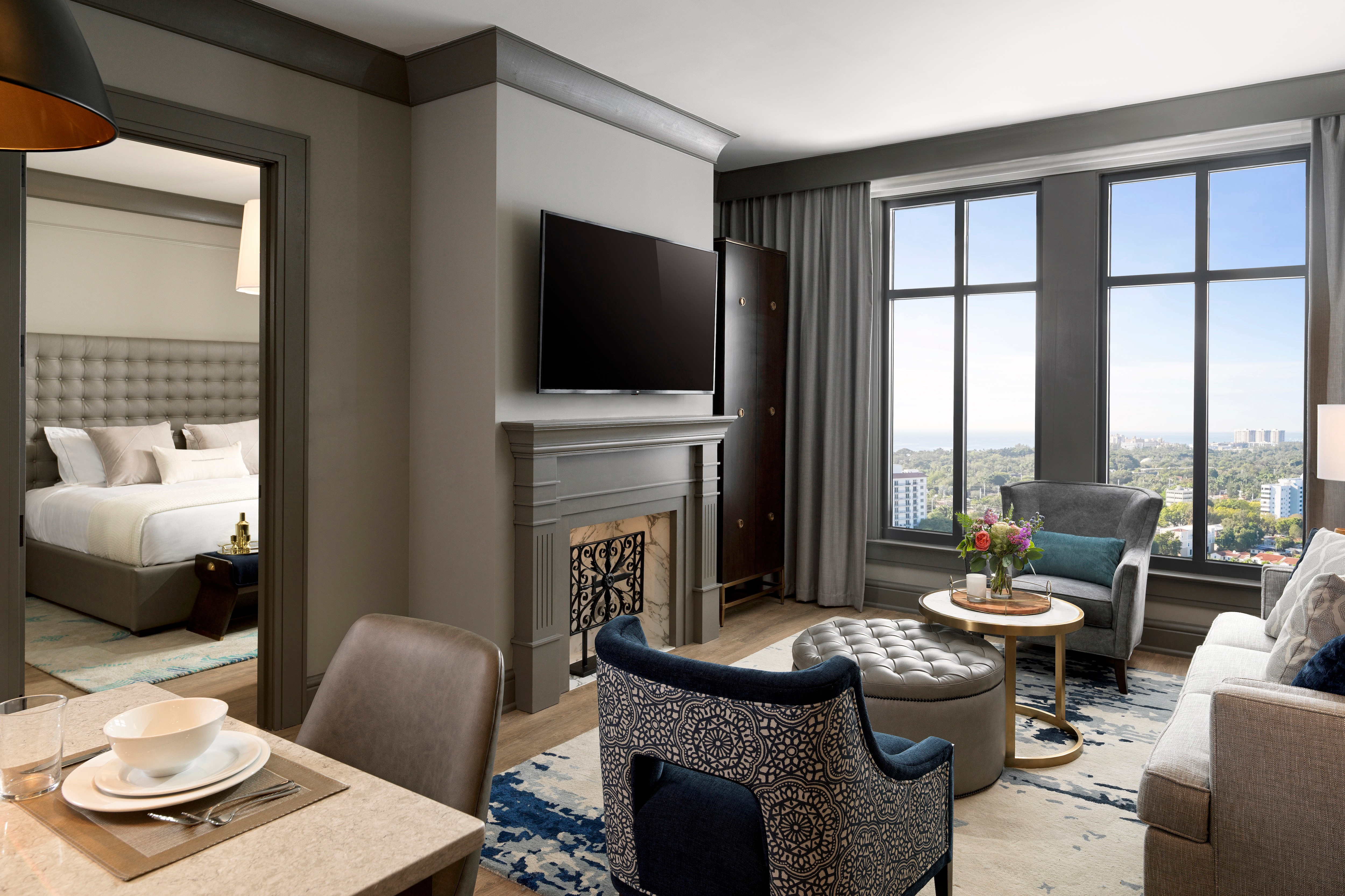 1-bedroom suite interior view, including living room and kitchen at Liberty Place Charleston by Hilton Club in South Carolina.