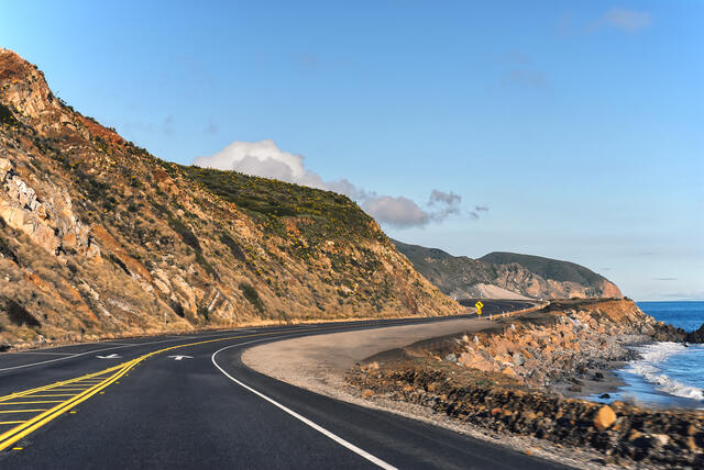 Close up of a mountain and road on a California coast road trip.