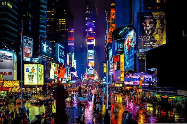 Times Square lighting up the night sky in New York City.
