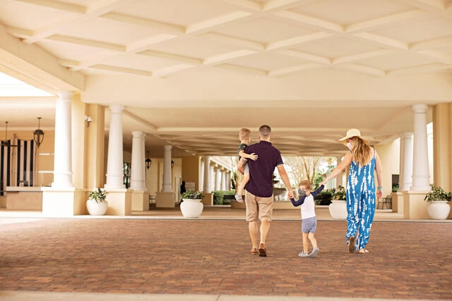 Family wearing face coverings while they arrive at Parc Soleil by Hilton Grand Vacations in Orlando, Florida.