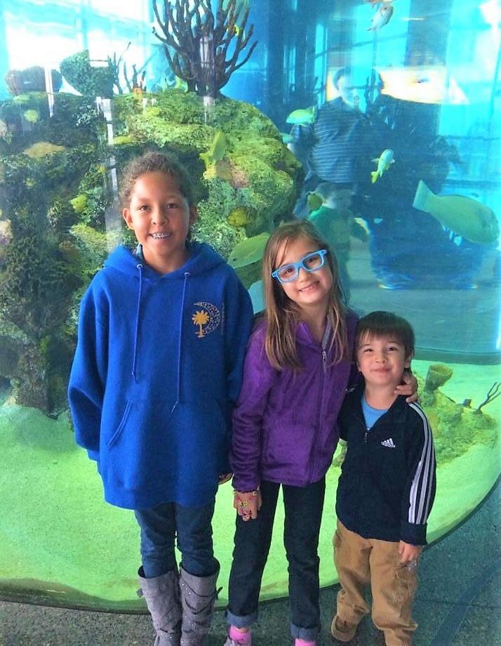Kids posing at South Carolina Aquarium.