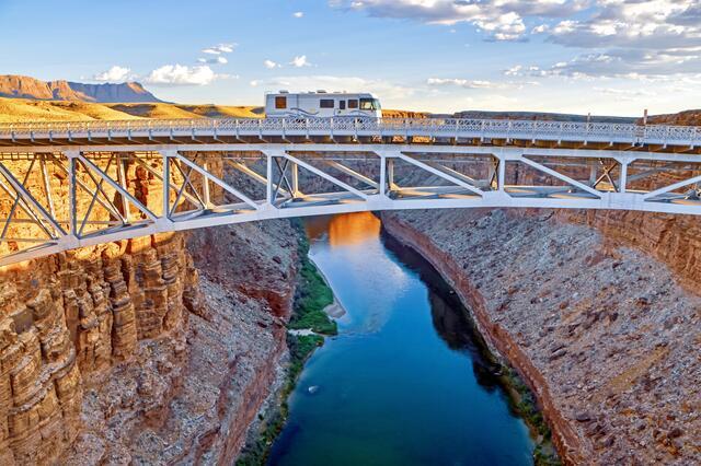 Picturesque shot of RV crossing bridge in the American west.