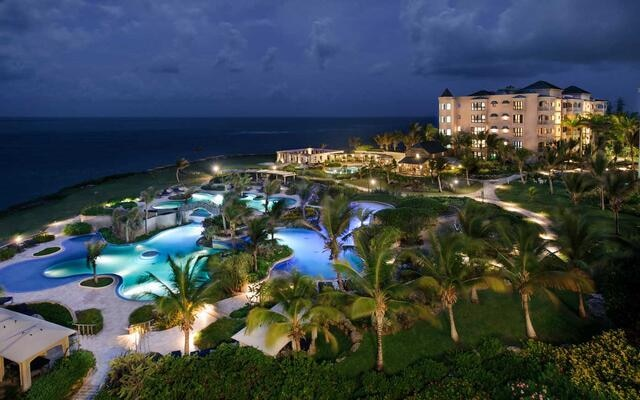 Aerial nighttime view of Hilton Grand Vacations at The Crane in Barbados.
