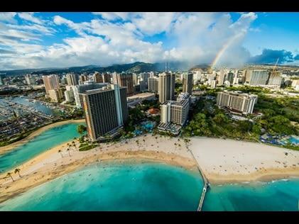Aerial view of rainbow over Hilton Hawaiian Village on Oahu in Hawaii.