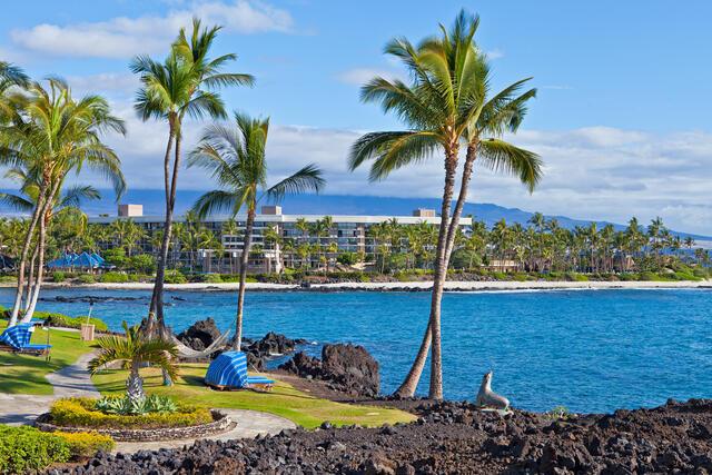 Palm trees, cabanas and hammocks at Hilton Hawaiian Village on Oahu in Hawaii.