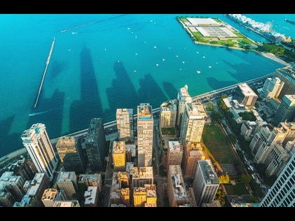 Stunning aerial view of the Chicago skyline where it meets the Lake Michigan shoreline.