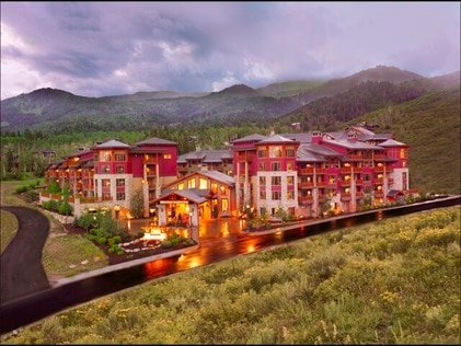 Aerial shot of Sunrise Lodge, a Hilton Grand Vacations Club nestled in mountains in Park City, Utah.