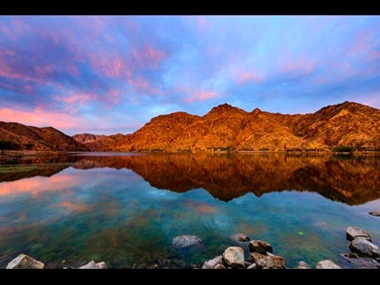 Scenic lake with boulders in the distance in Breckenridge, Colorado.