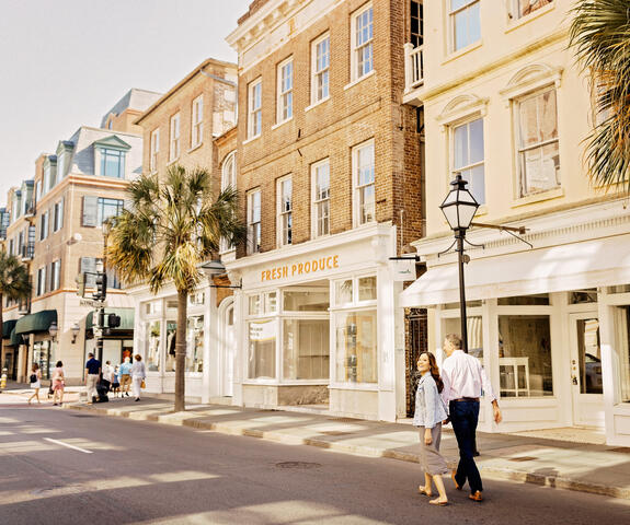 Couple walking hand in hand in Charleston, South Carolina.