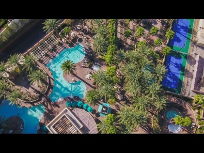 Aerial shot of recreational areas and palm trees at Hilton Grand Vacations on the Boulevard in Las Vegas, Nevada.
