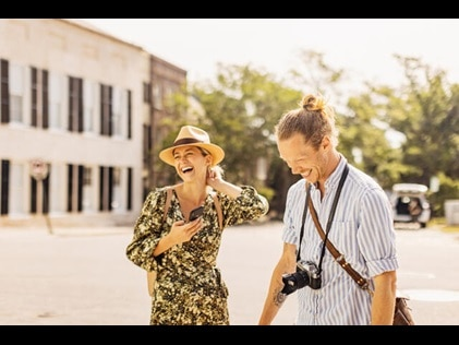 Couple laughing together while sightseeing in Charleston, South Carolina.