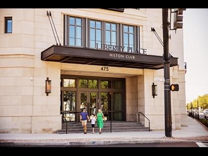 Family of three leaving Liberty Place Charleston by Hilton Club to explore Charleston, South Carolina.